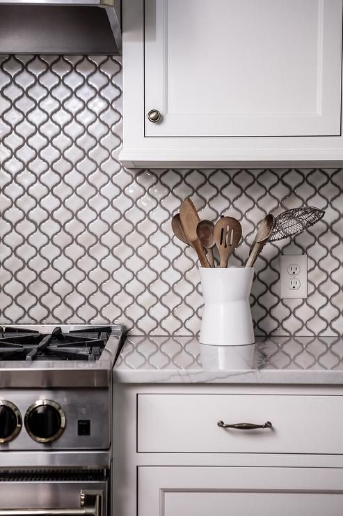 Gray Glass Tile Kitchen Backsplash: White Kitchen Cabinets Are Finished With A White Marble