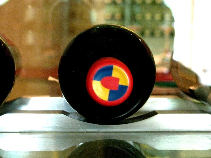 Close-up view of a bottle of Escudo Rojo 'breathing' on its side at Botticino (restaurant) at the Trident, Bandra-Kurla Complex, Mumbai. Red blue yellow (of the cap) are Escudo Rojo's house colours. [personal photo]