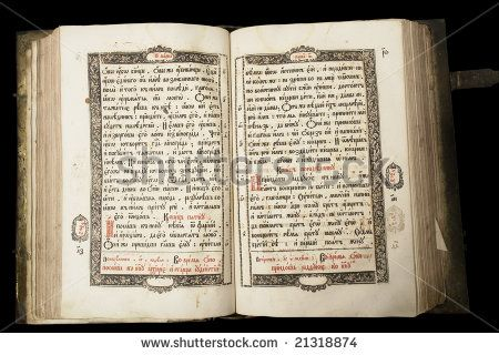 Beautiful old book (end of 17th century) on the dark background with clipping path. Russia - stock photo
