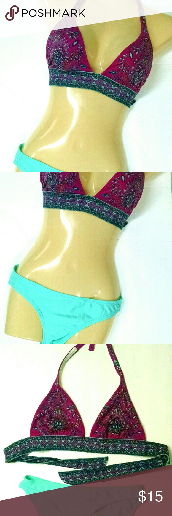 Featured!VS Bandana Bikini Top EUC This is an adorable top! Tag is partially removed, but it fits a M-L.  Tie is long, so it really depends on the kind of coverage you desire.This is a no support style. There are no places to insert padding :) I guess if you wanted you could simply wear the pads on the inside freely. Comment with questions! Victoria's Secret Swim Bikinis
