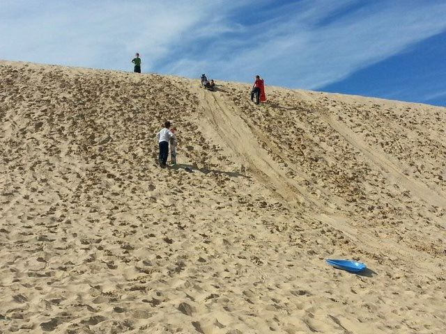 10 Fun Things to Do on the Outer Banks with Kids: Slide Down the Tallest Sand Dune in the East
