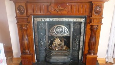 solid mahogany and cast iron fireplace