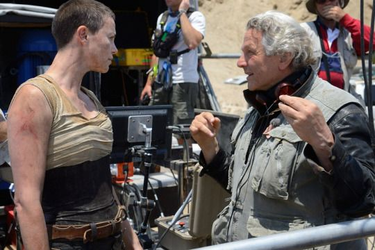 George Miller with Tom Hardy and Charlize Theron on-set of Mad Max: Fury Road (2015)