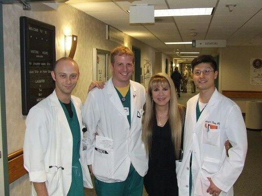 Stevie Nicks with doctors at Walter Reed Medical Center