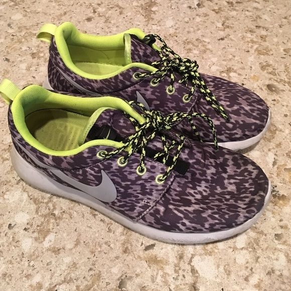 NIKE leopard and neon green running shoes So cute! Worn for a couple months this summer and have tons of life left. Only selling Bc I have too many grey shoes. Love these! Price firm to sell and no trade Nike Shoes Sneakers