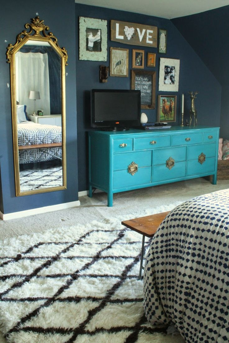 Primitive & Proper: Master Bedroom Updates:gallery wall around tv, moroccan rug, turquoise asian rug - navy wall