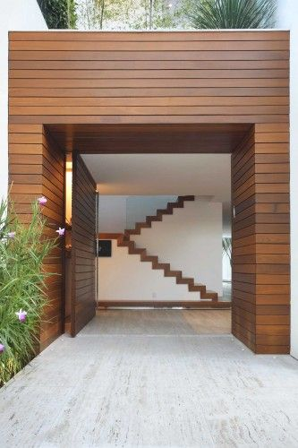 Unique entrance structure wood cladding stylish modern for Front door design for flats