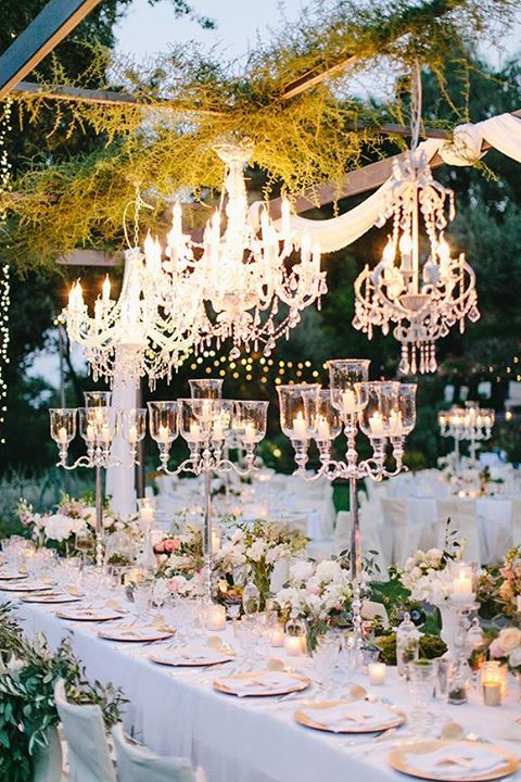 A little bit rustic, a whole lot glamorous - outdoor wedding with candelabras and chandeliers