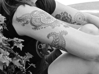 Found! Finally - Mehndi-style tattoo design with intricacy and elegance. Inside of the upper arm too. Had this idea for a year, finally found something to take to a parlour. Love that she's included the mandala too.