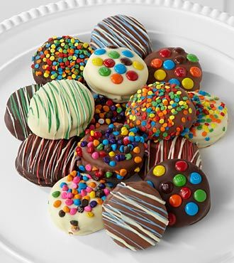 chocolate dipped oreo cookies decorate with m&m's, colored chips, sprinkles,colored chocolate