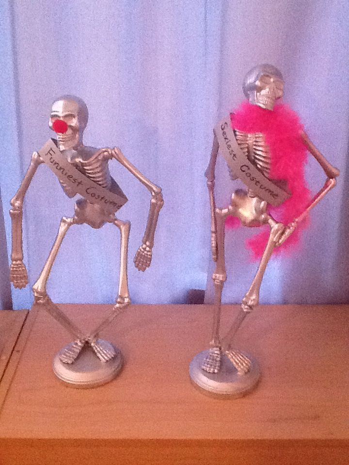 This person made cool trophies from dollar store skeletons as awards for best costumes for their Halloween party...very cool idea