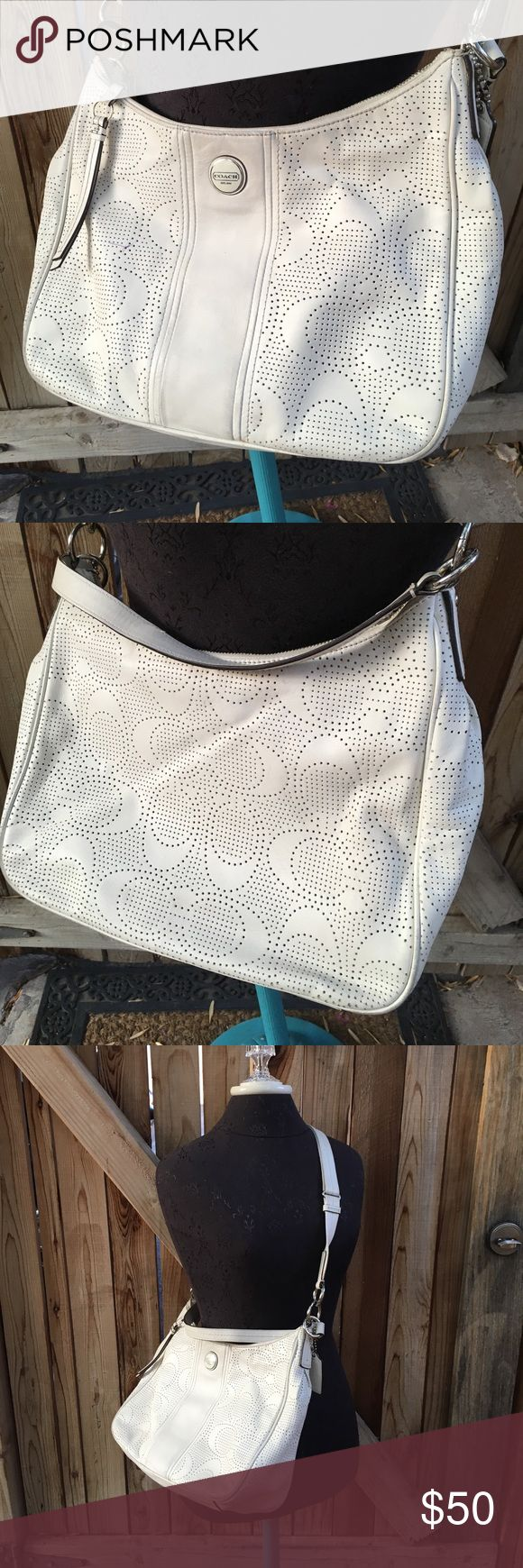 Coach Perforated Shoulder Bag Coach/White leather/2 straps on purse shoulder & Crossbody (can be removed) Perforated C logo, Measures 13 x 11 bag does show signs of wear. Free of tears but does have a pen mark at the front please see photos. Inside of Bag has been cleaned, but does have signs of nail polish spots & pen marks. Bag is still in overall good condition for use. Coach Bags Shoulder Bags