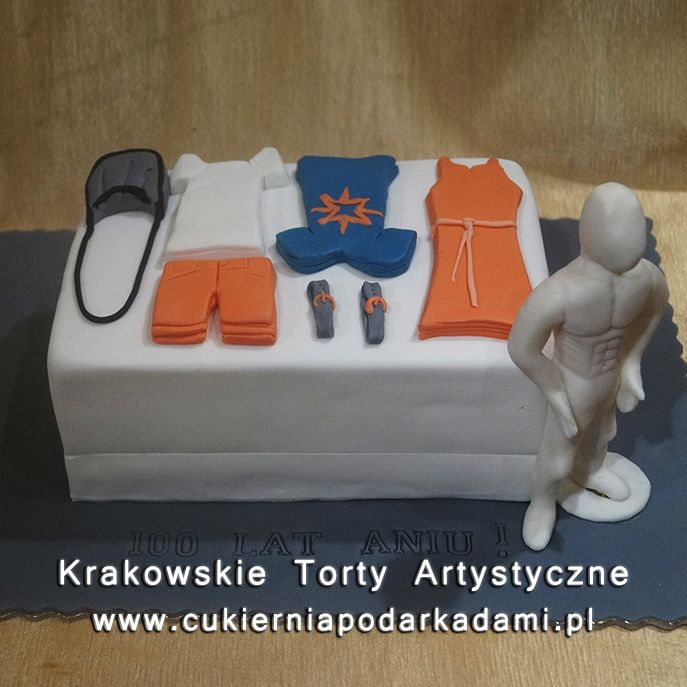 049. Tort z ubraniami i manekinem. Cake with clothes and mannequin.