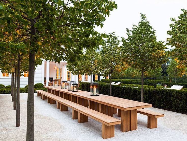 Really like this huge table. Would be super nice surrounded by orange trees. from the architectural firm of Sawyer/Berson