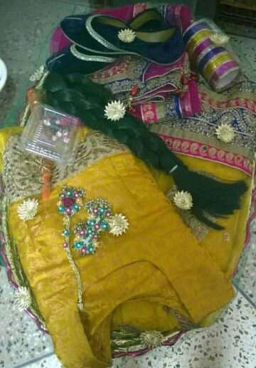 Mehndi clothes basket for my bhabi on her mehndi wrapped with net and gota flower.made by me