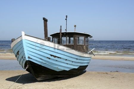 fishing boat on the baltic sea beach in heringsdorf usedom