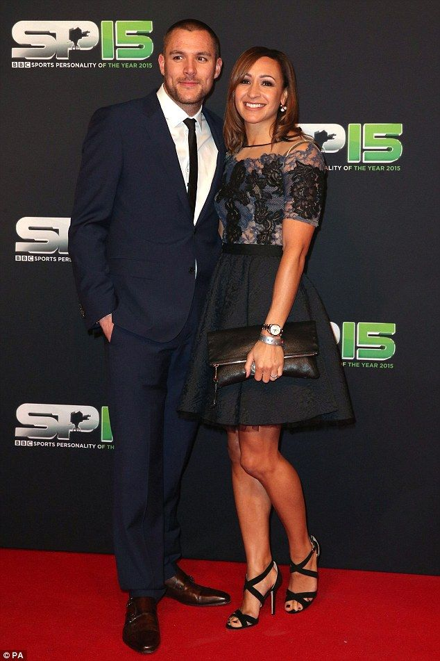 Happy couple: Jessica looked overjoyed to join her husband Andy Hill on the red carpet...