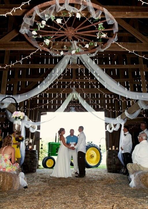 Old wagon wheel chandelier. My country barn wedding