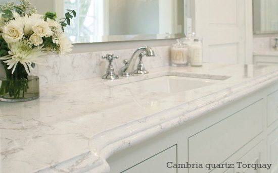 Cambria quartz bathroom countertop looks like Carrara marble - color Torquay;  (it's like caesarstone or Silestone)