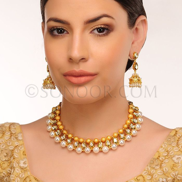 NEC/1/3423 Misa Necklace Set with Earrings in dull gold finish studded with kundan, golden ballsand pearl droplets  $128