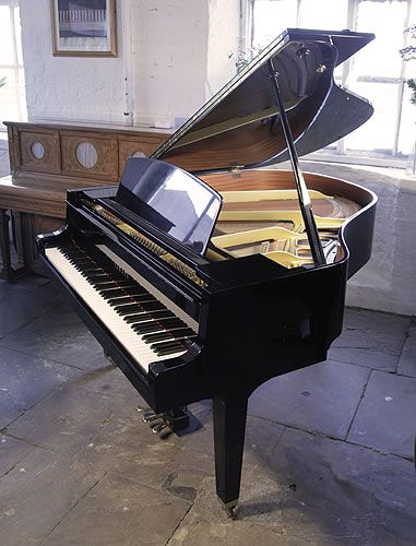 A 1994, Yamaha GH1 baby grand piano for sale with a black case and square, tapered legs at Besbrode Pianos. Piano has an eighty-eight note keyboard and a three-pedal lyre.