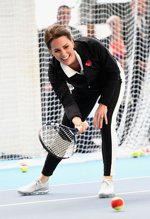 Kate plays a tennis match as she visits the Lawn Tennis Association at National Tennis Centre.