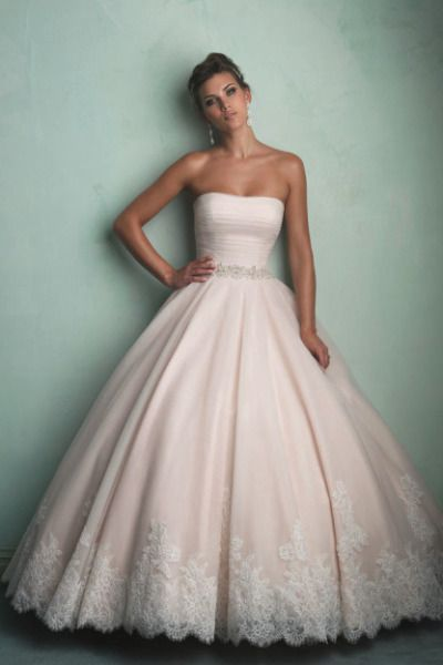 A pink ballgown from Allure Bridals: http://www.stylemepretty.com/2014/11/25/15-jaw-dropping-pink-wedding-dresses/ #SMPLookBook