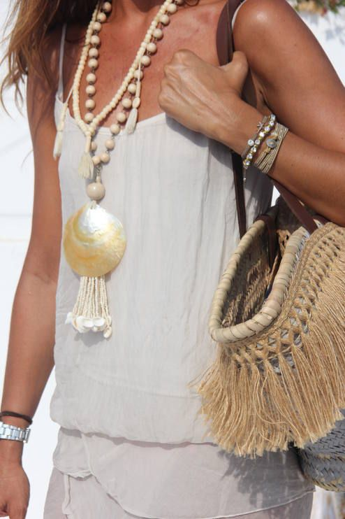 White For Summer by Mytenida. Wooden beads and shells with all white gauzy fabrics is a classic.