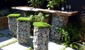 Resultado de imagen para rock wall garden designs