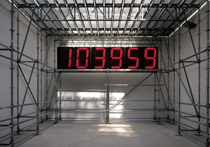 Metal scaffolding with digital clock.