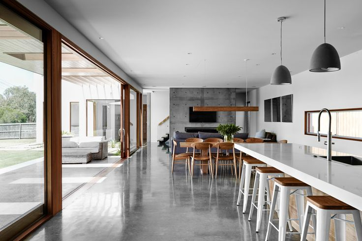 Love this space! Lots of natural light, hints of natural wood, cement look floor