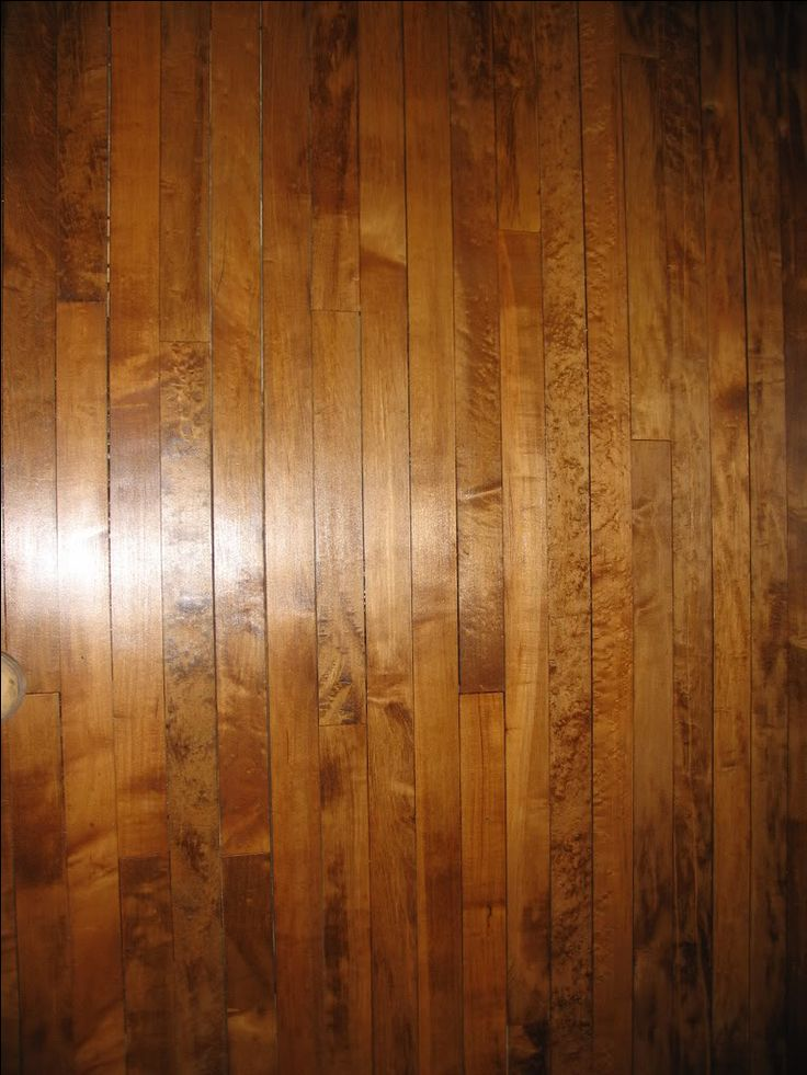 Maple floor with a dark stain - love it!  Good discussion about the difficulties of staining maple and how to do it right.