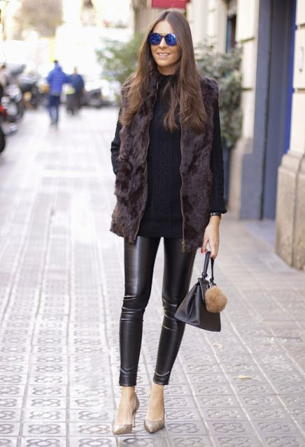 Leather leggings and faux fur make a fabulous combination. Sandra Buisanwears the trend with a casual knitted sweater and custom made patent heels; a stylish and easy fall outfit.Outfit: O8O Chic.