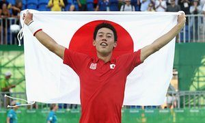 Kei Nishikori celebrates beating Rafael Nadal in the third place play-off to…