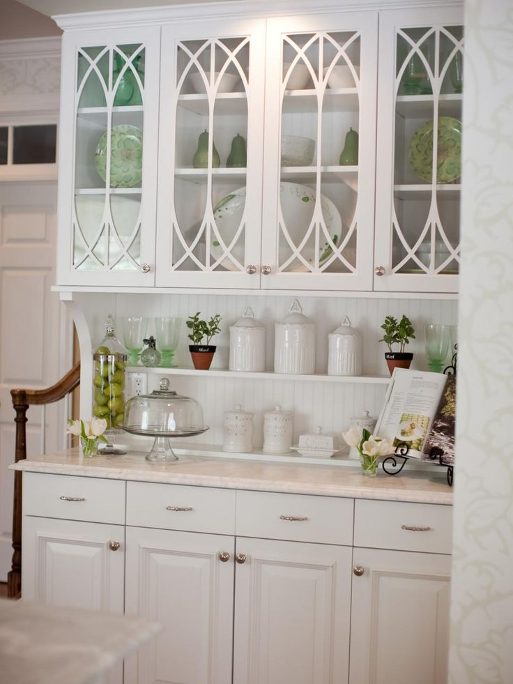 This built-in hutch with traditional glass cabinet doors, beadboard  backsplash and under-