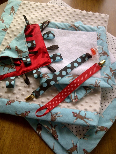 A matching set - Quilt, Receiving Blanket, Burp Clothe, Crinkle/Tag Toy and Pacifier Clips. Hello baby gifts!