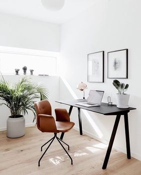 Minimalist Scandinavian home office in the Geiserne residential development in Horsens, Denmark. The chair is the Primum Chair by Bent Hansen in Denmark.