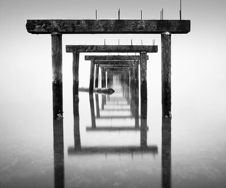 Wood pier and reflection | Lawrence Hislop Photography