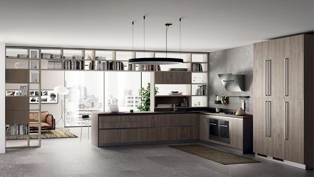 """Стеновая система """"Fluida"""" в декоративной отделке Серая Чайка украшает пространство кухни благодаря совершенной модульности по высоте и ширине; предлагается также в исполнении с дверцами. Разделить и связать воедино зоны интерьера, благодаря декоративному проему, выходящему в смежное помещение, - такова функция этого элемента, устанавливаемого у стены, в центре комнаты или в проходном помещении; его можно выбрать в нужной высоте вплоть до потолка."""