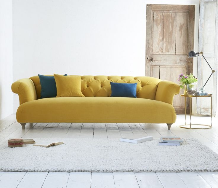 Our Dixie sofa would brighten up any grey day! Just look at it's sunny yellow hue. Pair with contrasting pops of blue for a statement look. Find out what other bright shades HomeGirl London has suggested in her latest round-up: http://homegirllondon.com/happy-yellow-living-room-ideas/
