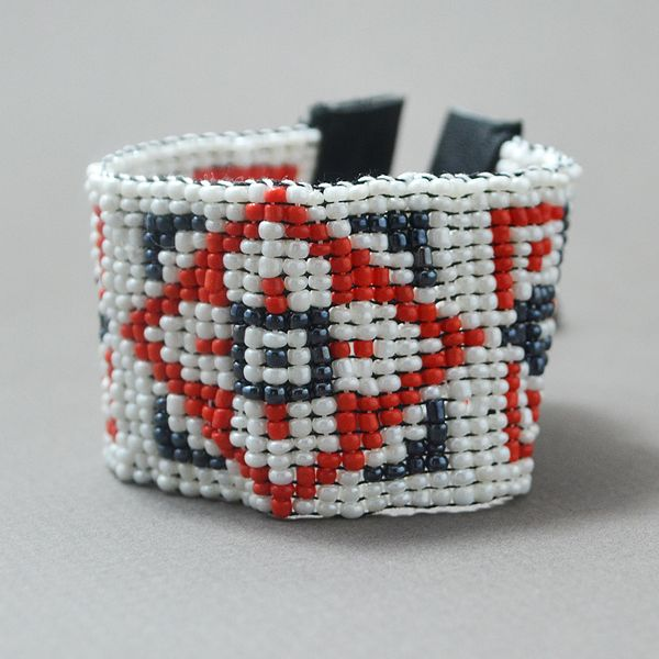 A carefully hand woven beaded bracelet, made ​​of high quality beads. The bracelet is adjustable and the colors used are: White, metallic black & red. The bracelet's dimensions are: 1,57 inches (4 cm) in width (19 lines) and 6.3 inches (16 cm) in length. Since there is a huge variety of colors. I can create the perfect bracelet for you with no extra cost. Please contact me for any questions or clarifications.