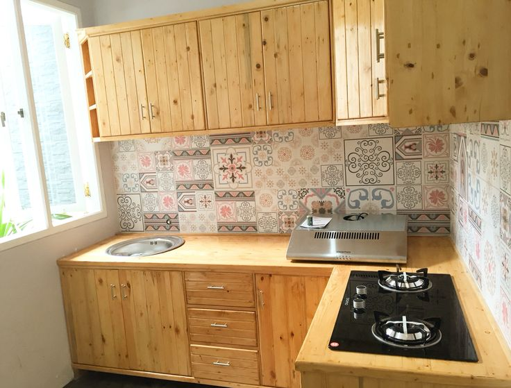 Before after renovation house with low budget. Kitchen with wood pallet and flower tiles