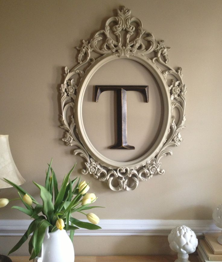 Spray painted Ikea frame and monogram letter from Hobby Lobby at front door entry.