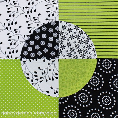 Quarter Circle Quilt Block Pattern - The Quarter Circle Quilt Block Pattern is made up of four machine-appliqued, quarter-square scrappy units. These simple quilt blocks use a variation on the traditional drunkard's path quilt pattern to create a colorful circle set against a black, white, and green background.  xxx