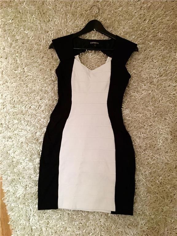 Svartvit klänning med cool baksida strl 36/38 - 39 kr