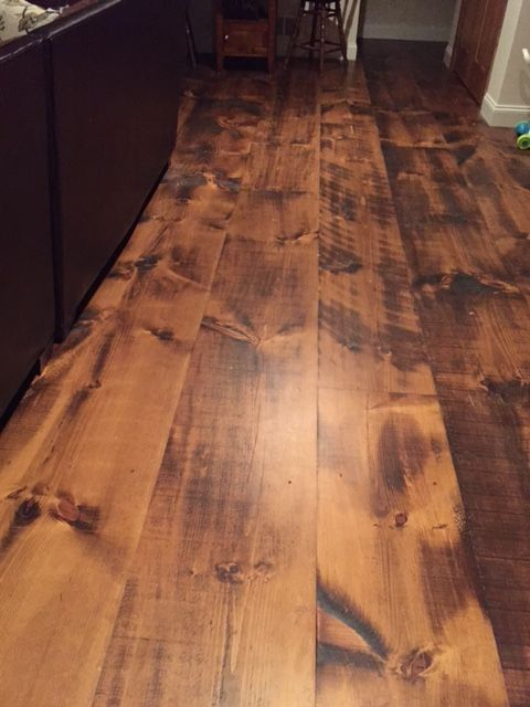 Wide plank pine flooring with circular saw marks and skip planing.
