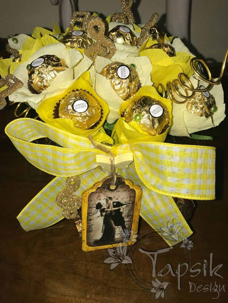 Chocolate flower bouquet in the colors of yellow-beige. This time for music-dance lover. 17 pieces of choco flowers. Yellow bow, music notes and instruments. Decorated tag. In a mug. Notes and tag are hand decorated.