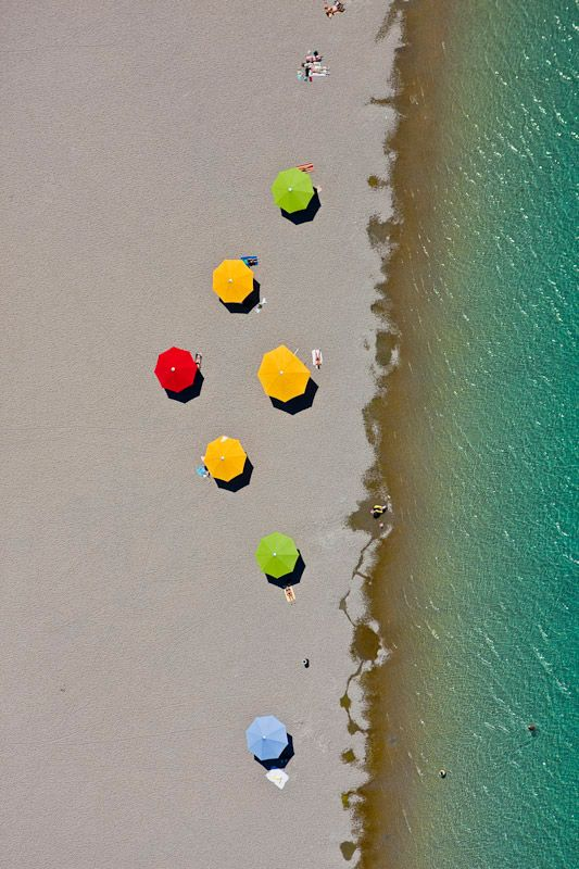 Aerial view of colorful umbrellas on the beach  [ AutonomousAvionics.com ] #Aerial #avionics #technology