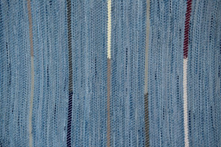 Scandinavian rug inspiration for jeans recycling pieced fabric, mixing stripes of black, cream and brown.  Would be great for a long duster coat jacket.