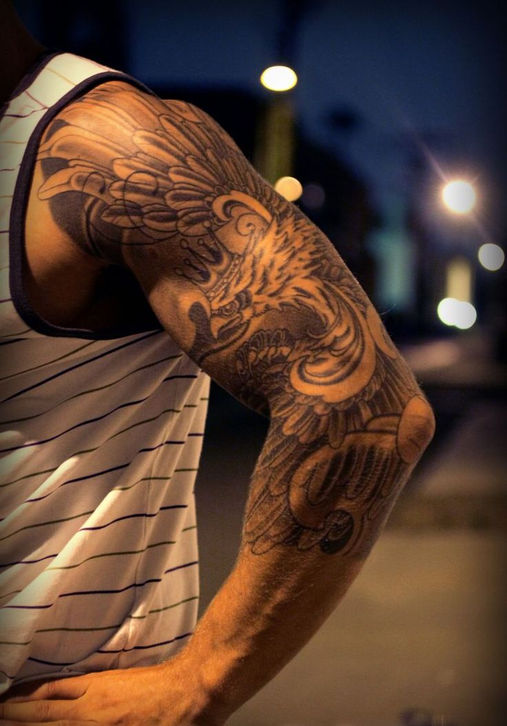 Amazing realistic black and grey phoenix with crown tattoo